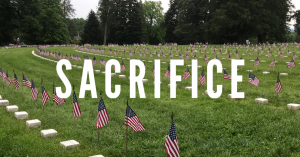 Sacrifice with American flags at a cemetary